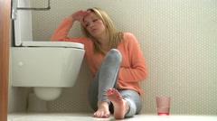 Stock Video Footage of Teenage Girl Feeling Unwell In Bathroom