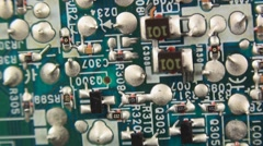 Stock Video Footage of Panning left to right of old analog TV circuit-board