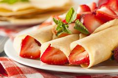 Stock Photo of fresh strawberry french crepes