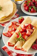 fresh strawberry french crepes - stock photo
