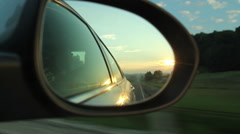 Side mirror view of sunrise in the country Stock Footage