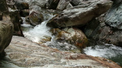 Fresh and Cold Mountain Stream Between Rocks - stock footage