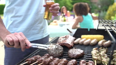 Close Up Of Of Man Cooking On Barbeque At Home Stock Footage