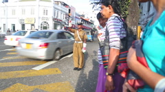 Local policeman working on the street in Kandy. Stock Footage