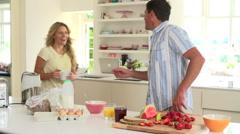 Parents Preparing Family Breakfast In Kitchen - stock footage