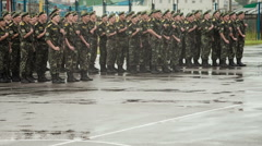 Ukrainian cadets sing the anthem on the parade ground in the rain - stock footage