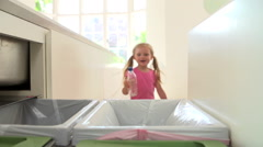 Slow Motion Sequence Of Girl Recycling Kitchen Waste In Bin - stock footage