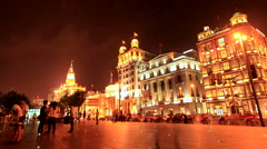 Shanghai The Bund night with Crowd 2 time lapse 24 zoom in Stock Footage
