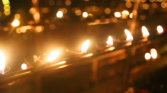 The view of burning candles in the Temple of the Tooth. Stock Footage
