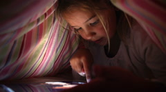 Girl Looking At Digital Tablet In Under Bed Cover At Night Stock Footage