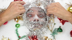 Man under christmas decorations, winter concept Stock Footage
