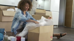 Woman Packing Boxes Ready For House Move Stock Footage