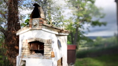 Wood-fired oven in the countryside. - stock footage