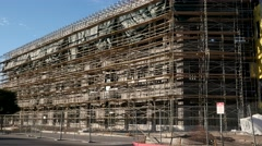 PAN SCAFFOLDING ON NEW BUILDING 4K Stock Footage