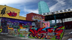Graffiti on buildings with train in NYC Arkistovideo