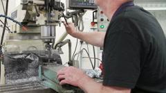 Engineer Drilling Metal Block In Factory Stock Footage