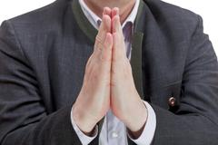 front view of businessman praying hands - stock photo