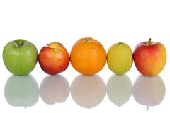 Fruits like oranges, lemons and apples in a row isolated Stock Photos