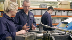 Engineer Teaching Apprentices To Use Tube Bending Machine Stock Footage