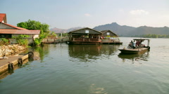 KANCHANABURI, THAILAND - FEBRUARY 2014: Commuter passing river kwai ferry Stock Footage
