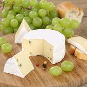 soft cheese like camembert or brie with grapes - stock photo