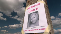 Missing person poster with photo of little girl - stock footage