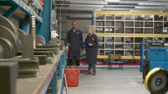 Worker And Apprentice Checking Stock Levels In Store Room Stock Footage