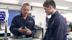 Engineer Demonstrating Machinery To Apprentice - stock footage