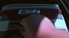 Person takes out a suitcase from the car trunk POV Stock Footage