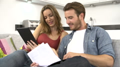 Couple Checking Personal Finances Using Digital Tablet - stock footage