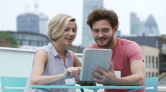 Couple In Outdoors In Urban Setting With Digital Tablet Stock Footage
