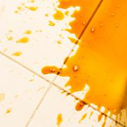 Spilled coffee on the floor Stock Photos