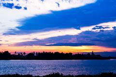 Sunset at temple riverside chao phraya river Stock Photos