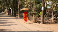SILK ISLAND, CAMBODIA - MARCH 2014: buddhist monk walking - stock footage