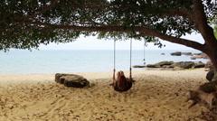 Tourist girl enjoying at swing at beach, sihanoukville, cambodia Stock Footage