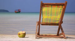 Sunbed and Coconut ready for holiday Stock Footage