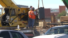Large forklift as workers off load material medium shot Stock Footage