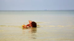 Woman sunbathing crystal water drinking coconut enjoying vacation, cambodia Stock Footage