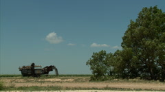 Old agricultural machinery in Oklahoma plains - stock footage