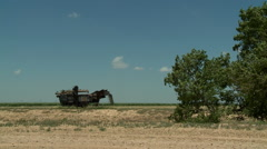 Old Harvester in Oklahoma plains Stock Footage