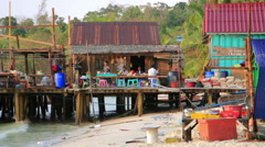 KOH RONG, CAMBODIA - MARCH 2014: noodle restaurant on waterfront Stock Footage