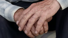 Senior male hands with scraped knuckles and chipped black nails - stock footage