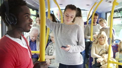 Passengers Standing On Busy Commuter Bus Stock Footage