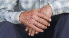 Tired scraped hands of elderly farmer Stock Footage