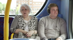 Senior Couple Being Harassed On Bus Journey Stock Footage
