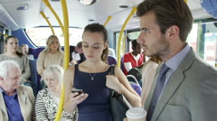 Two Young Women Reading Text Message On Bus Stock Footage