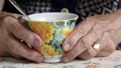 Senior woman hands holding cup of some drink - stock footage