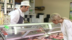 Butchers Serving Customers In Shop Stock Footage