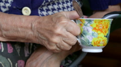 Senior woman hands holding cup of tea closeup Stock Footage