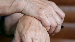 Gesticulating hands of senior woman during a conversation close-up Stock Footage